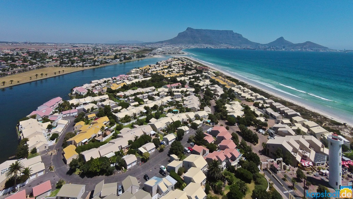 Aerial drone image of Woodbridge Island with its Lighthouse towards Table Mountain