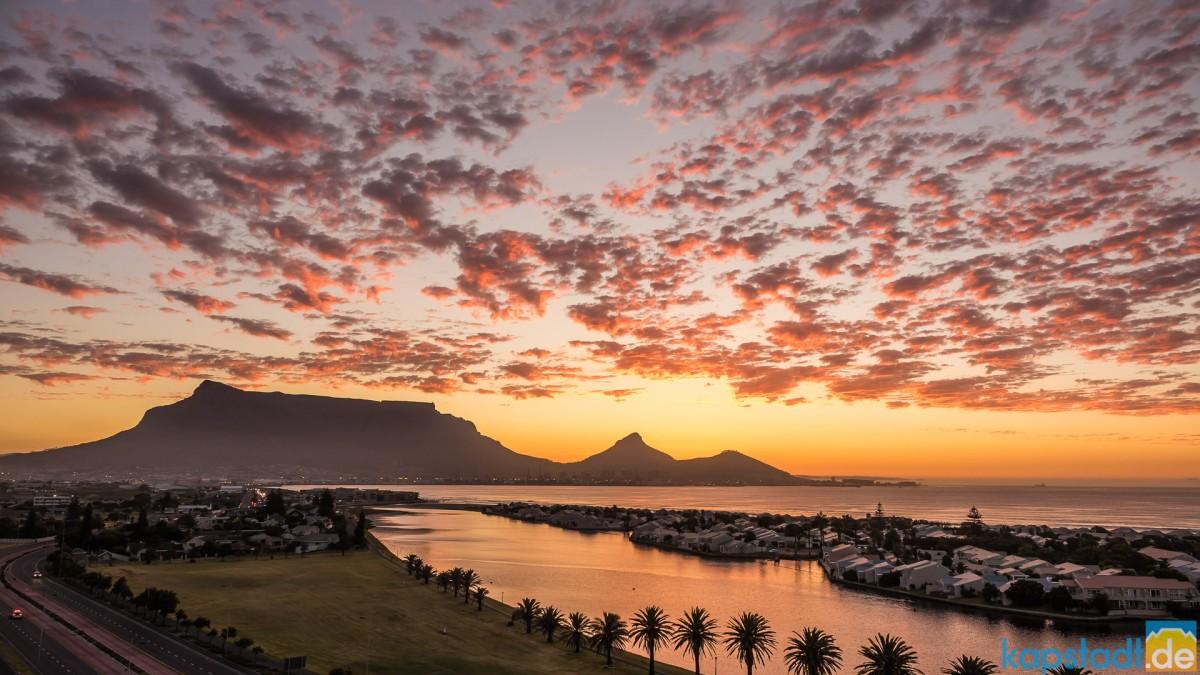 Milnerton sunset with Woodbridge Island and Table Mountain