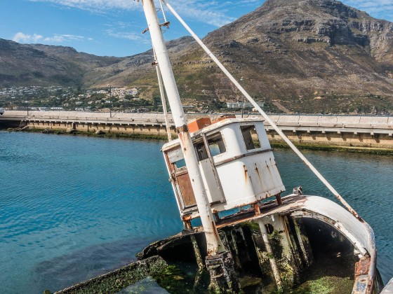 Hout Bay harbour and a sunken ship