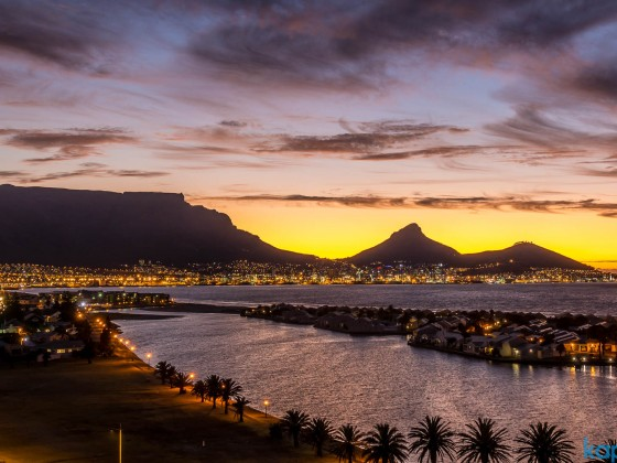 Table Mountain with Woodbridge Island in Milnerton after sunset