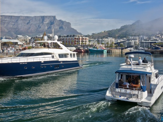 Yacht and a luxurious motorboat at the V&A Waterfront