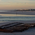 Part of an old shipwreck after sunset at the Milnerton Lagoon