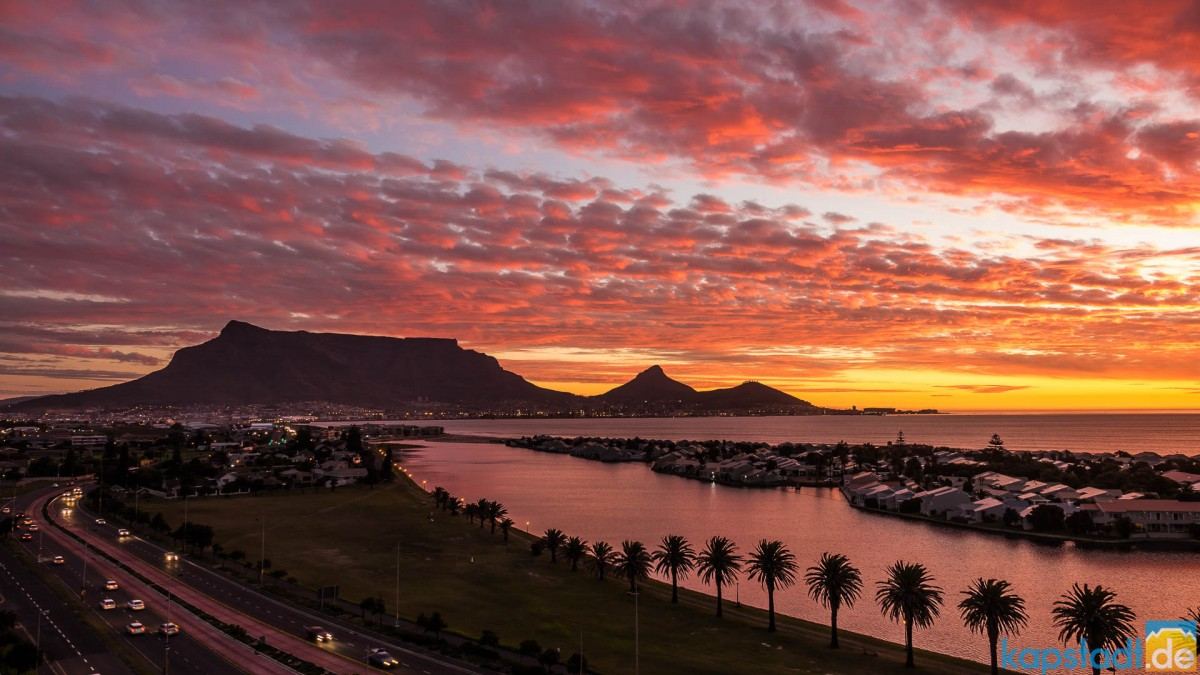 Table Mountain with Woodbridge Island in the evening during sunset seen from Milnerton