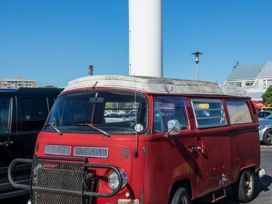 Old Volkswagen Bulli on Woodbridge Island with its Lighthouse
