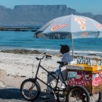 Ice seller at Bloubergstrand with Table Mountain