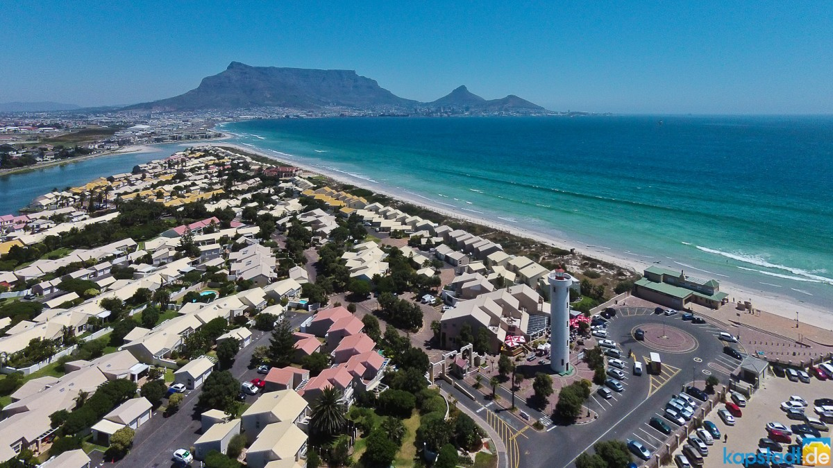 Aerial drone images of Woodbridge Island with the Lighthouse, the Milnerton Lagoon and Table Mountain