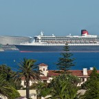 Queen Mary II passing the Green Point stadium seen from Milnerton