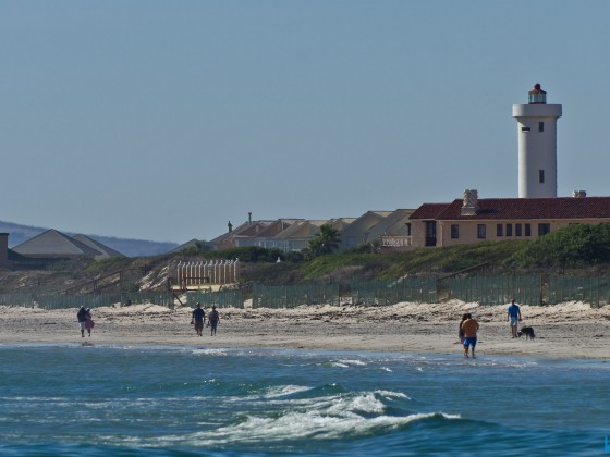 The beach of Milnerton with the Lighthouse on Woodbrige Island