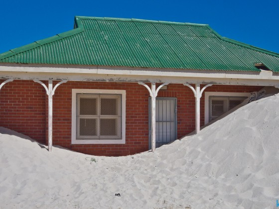 House covered by a dune in Hout Bay