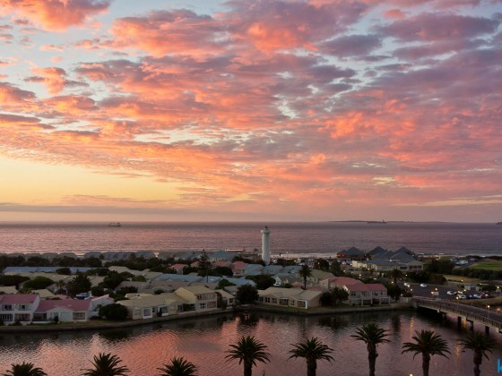 Sunset clouds over Woodbridge Island in Milnerton