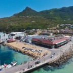 "Aerial drone image of the Hout Bay Harbour and it's seafood restaurant ""Wharfside Grill Restaurant"""