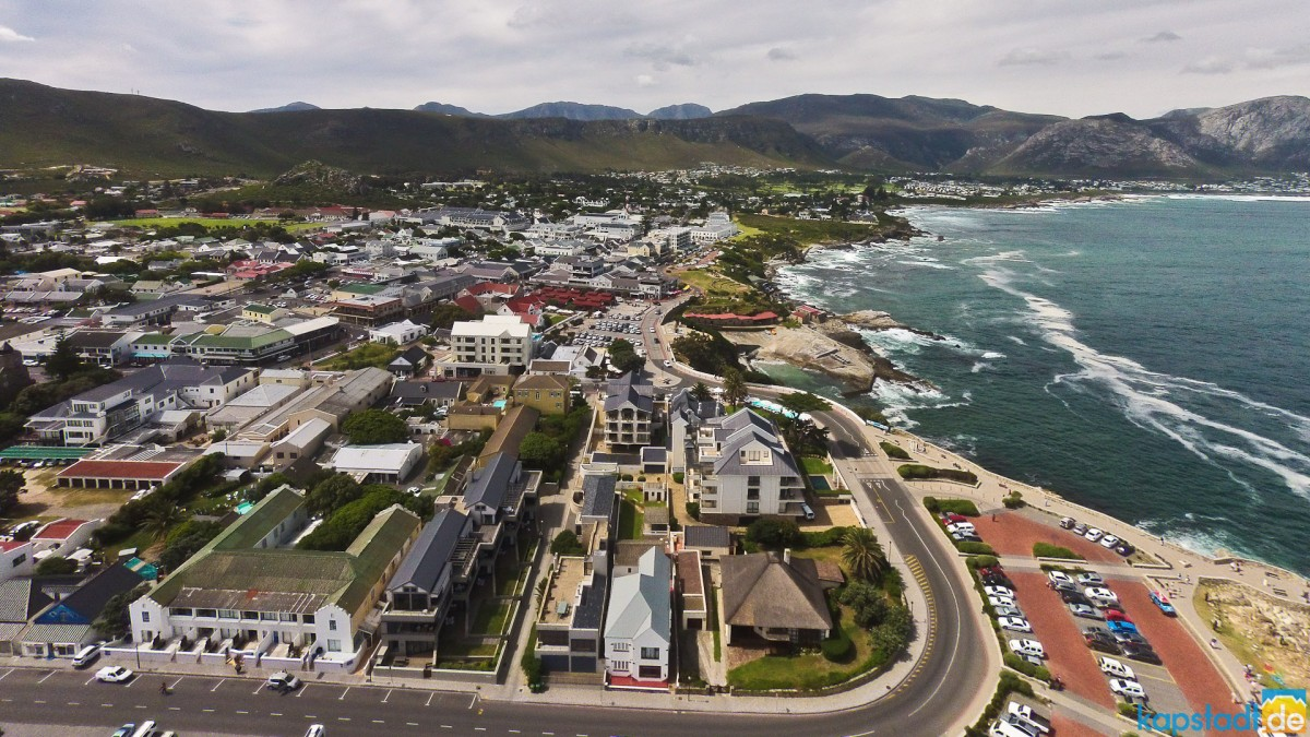 Aerial from the beach front of Hermanus with its old harbour