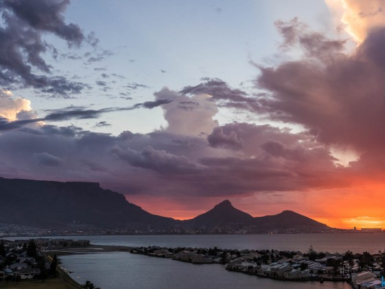 Sunset with clouds over Table Mountain in Cape Town