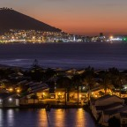 Woodbridge Island and the V&A Waterfront in the distance after sunset