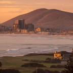 Milnerton golf course with Bloubergstrand in the distance during sunset