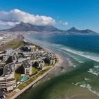 Aerial drone image of the Milnerton Lagoon Hotel and Complex with Table Mountain