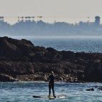 Stand Up Paddling with Robben Island with strange water refelctions