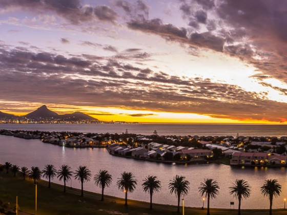 Table Mountain and Woodbridge Island panorama in the evening after sunset seen from Milnerton