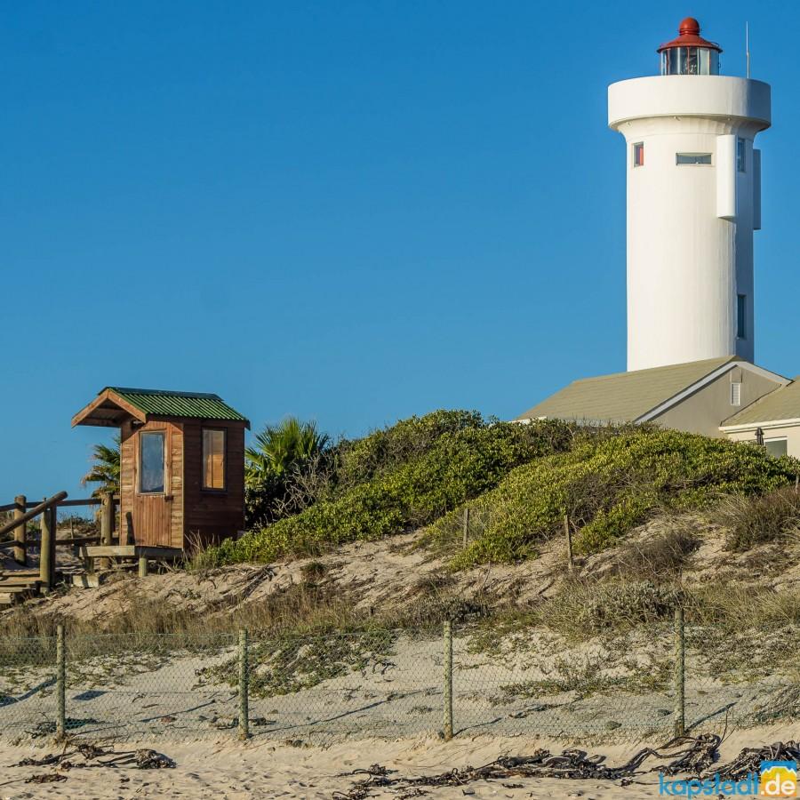 Woodbridge Island Lighthouse with security house on the beach