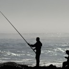 Fishing on the rocks of Bloubergstrand