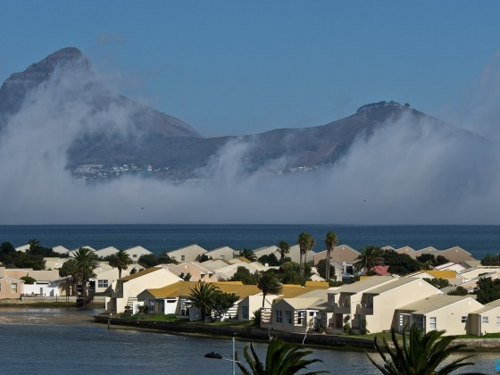 Lion's Head and Signal Hill with some mist in Table Bay