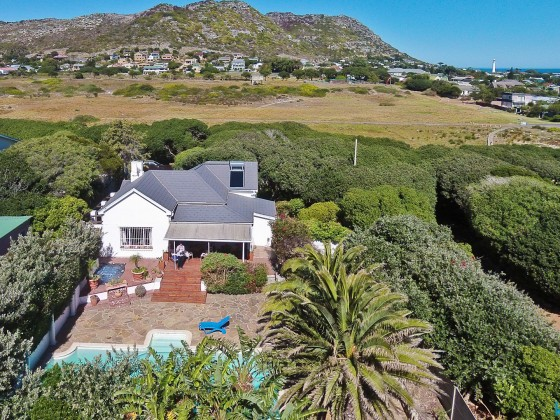 "Aerial drone image of ""Milkwood Cottage"" in Kommetjie"