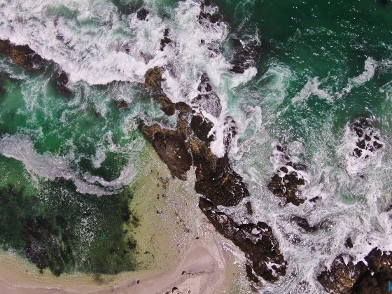 Aerial image straight down to the rocks of Bloubergstrand