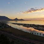 Aerial drone image with the sunset over Table Mountain, the Milnerton Lagoon and Woodbridge Island