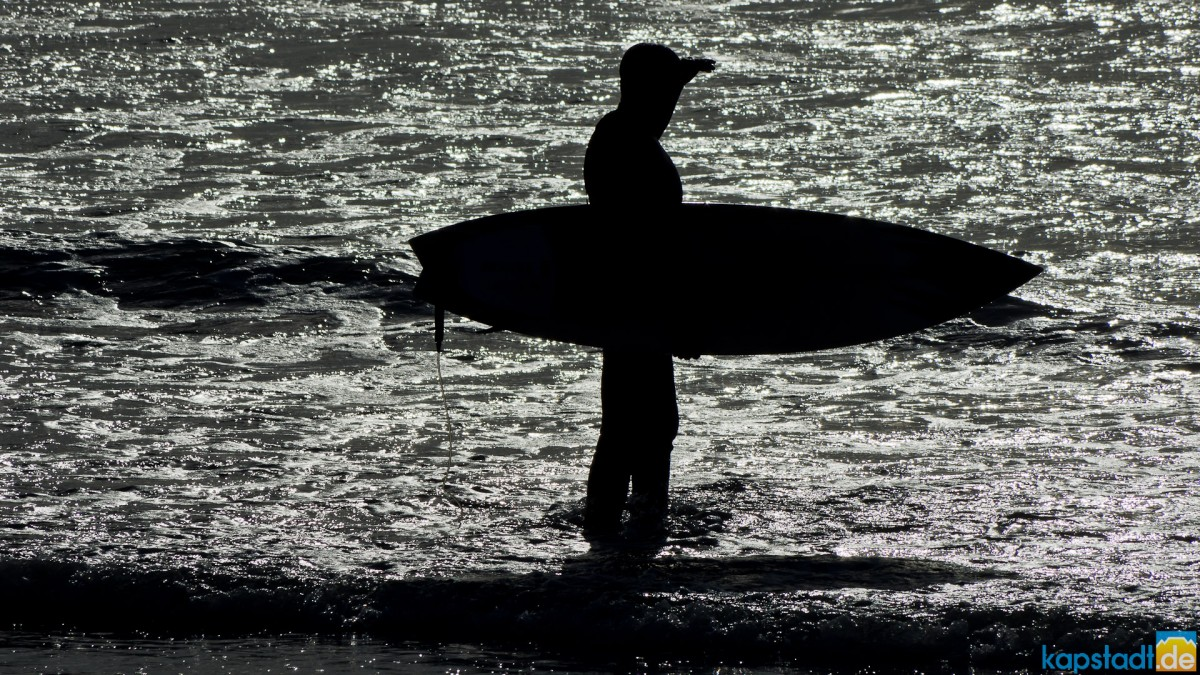 Surfer at Bloubergstrand taken against the sun